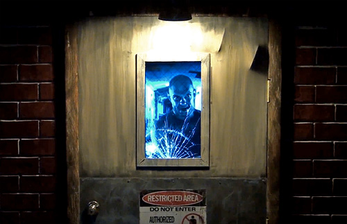 Animatronic Asylum Door Prop (Image courtesy YouTube)