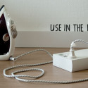 PlugBook Is An Extension Cord/Power Strip That Looks Like A Book