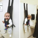Responsible Parenting: Hang Your Baby Up On A Stall Wall While You Go About Your Business
