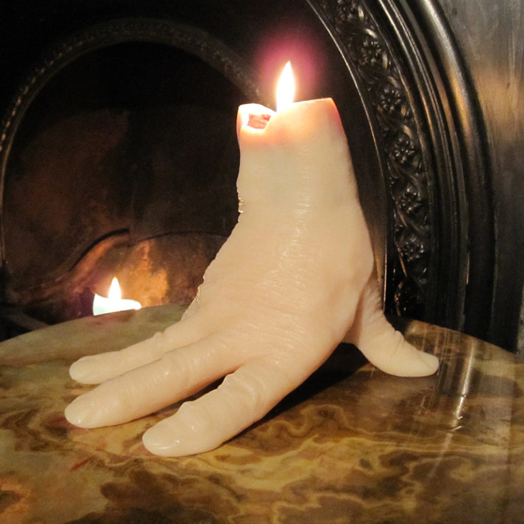 hand-candle-bleeds-as-it-burns-xl