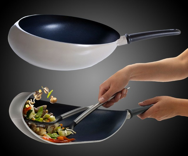 boomerang wok helps you keep your food from flying around. Black Bedroom Furniture Sets. Home Design Ideas