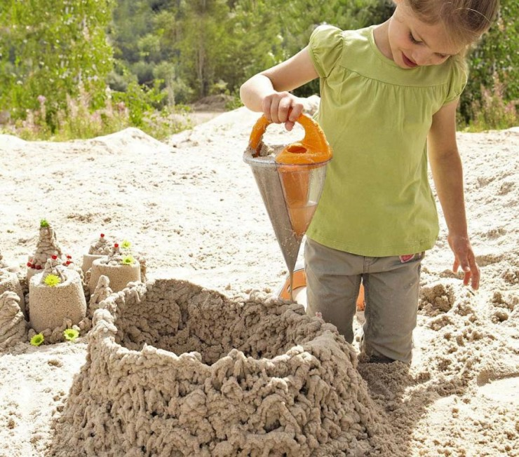this-sand-funnel-mixes-water-and-sand-to-create-sand-structures-0