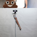 Man Adds Distorted Sticker To Selfie Stick, So It Comes Out Looking Normal On The Image